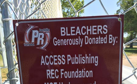 Access Publishing raises funds for new bleachers for youth baseball