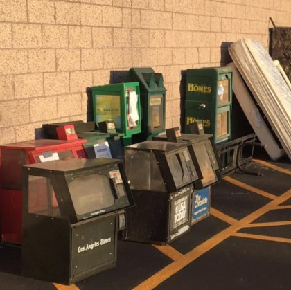 Print newspaper racks sit next to a dumpster behind the Albertson's grocery store in Paso Robles. The shopping center management had given the publications notice to remove the racks by May 31.