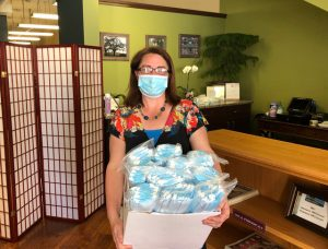 local business owner holding medical masks